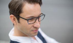 man wearing industrial frames