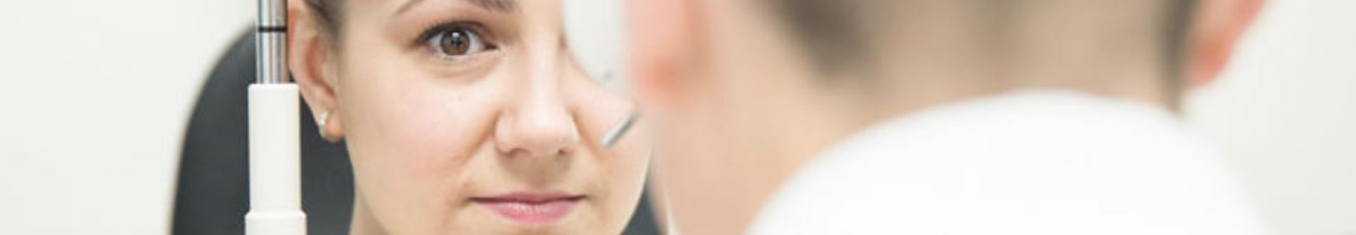 Woman getting eye exam with doctor